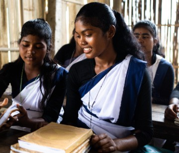 girls in a classroom with books